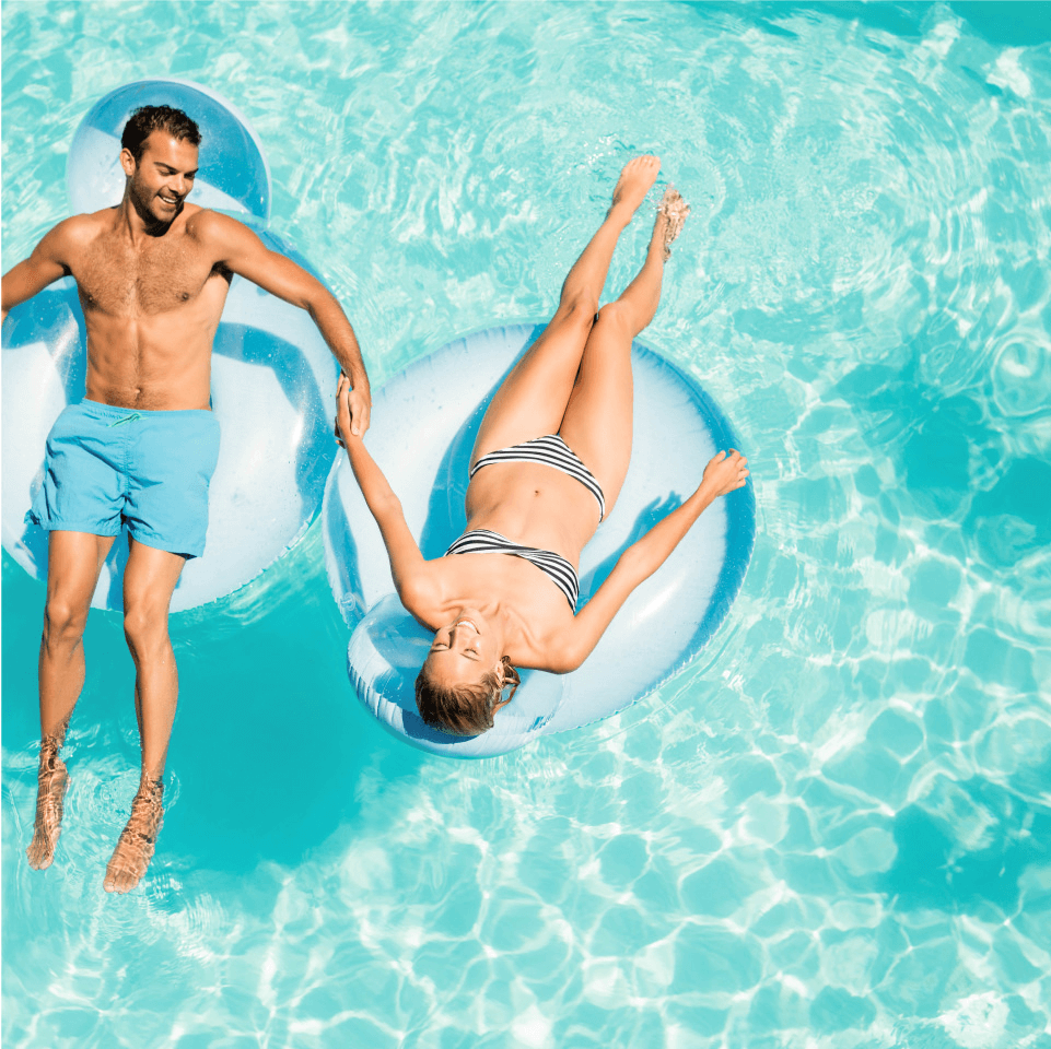 Couple sitting on inflatable inner tube